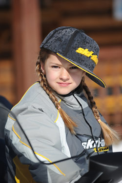 Young girl snowmobiling