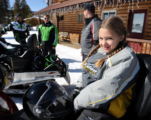 A girl on a snowmobile