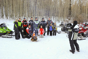 A group of snowmobilers