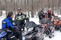 Snowmobilers chatting