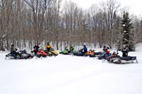 Snowmobilers enjoying snowmobiling