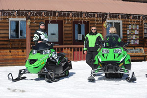 snowmobilers take a break