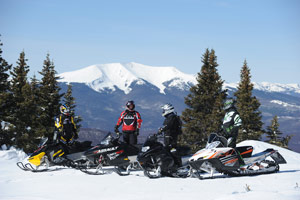 Snowmobiling along a beautiful vista