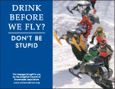 Horizontal Poster of Snowmobilers and text 'Drink Alcohol Before We Fly? Don't Be Stupid'