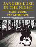 Vertical Poster of Snowmobilers and text 'Dangers Lurk In The Night. Slow Down. Pay Attention'