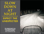 Horizontal Poster of Snowmobilers and text 'Slow Down at Night. Expect the Unexpected'