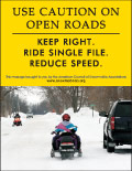 Vertical Poster of Snowmobilers and text 'Use Caution on Open Roads. Keep Right. Ride Single File. Reduce Speed.'